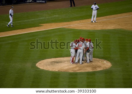 BRONX, NY - OCTOBER 17: The LA Angels huddle on the mound during game 2 of the ALCS at Yankee Stadium on October 17, 2009 in the Bronx NY.