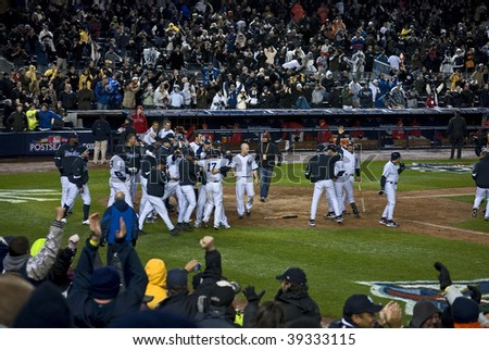BRONX, NY - OCTOBER 17: The Yankees celebrate at home plate after winning game 2 of the ALCS at Yankee Stadium on October 17, 2009 in the Bronx, NY.