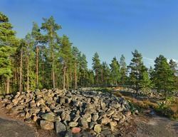 Bronze Age Burial Site of Sammallahdenmaki, Finland, UNESCO World Heritage Site. 30 granite burial cairns, providing a unique insight into the funerary practices and social and religious structures