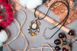 Bronze and amber pendant in the form of scarab.