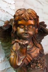 Bronze Angel blowing a kiss