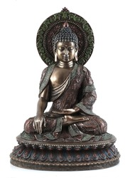 Bronze buddha statue isolated over white with clipping path.