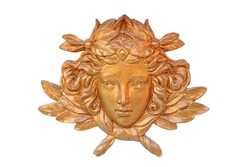 Bronze cast of lady face and flower isolated on white