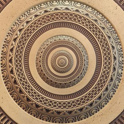Bronze copper geometrical abstract ornament round fractal pattern background. Metal circle pattern effect background. Concept abstract symmetrical pattern. Abstract inside out effect background
