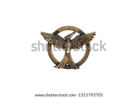 bronze emblem with a bird #1315793705