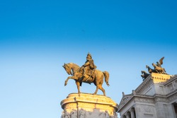 Bronze equestrian sculpture (profile) with the first king of the united Italy Vittoriano Emmanuel II against the backdrop of the sunset. View Profile. Located on Piazza Venezia in Rome.