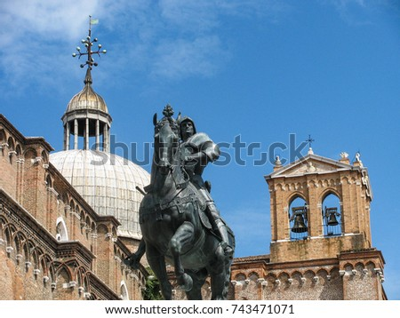 Bronze equestrian statue Bartolomeo Colleoni in front of the Renaissance Basilica of Saints Giovanni and Paolo in Venice, Italy, created by Andrea del Verrochio in 1480-1488.