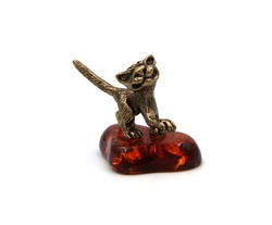 bronze figurine of a cat on a white background