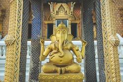 Bronze Ganesha statue and Golden texture ganesh is hindu god in temple thailand.