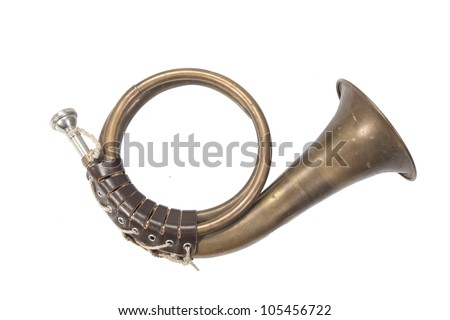 bronze hunting horn isolated on a white background