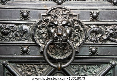 Bronze knocker in the shape of a lion head from the gate of the Cologne Cathedral, Germany