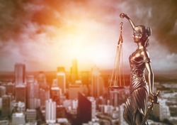 Bronze lady with scale, symbol of justice and law on city background