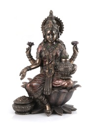 Bronze Laxmi Mata statue isolated over white with clipping path.