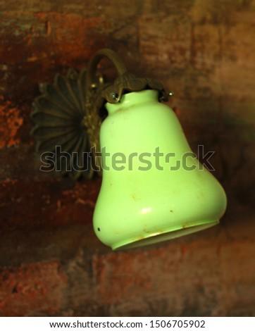 bronze light wall lamp on brick wall #1506705902