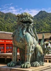 Bronze Lion dog statue in Itsukushima, Japanese Shinto Shrine on Miyajima Island, Japan.