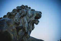 Bronze lion sculpture, oldest street in the capital of Spain, the city of Madrid