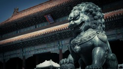 Bronze lion statue,Guarding the gate of the Forbidden City Palace,the chinese word in photo means