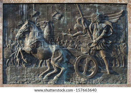 Bronze relief of Alexander the Great riding the chariot. Skopje, Macedonia