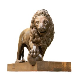 Bronze sculpture of a lion. Isolated on a white background.