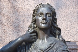 Bronze sculpture of a long-haired woman