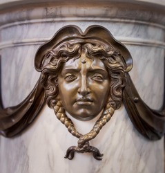 Bronze sculpture of a mourning female face, classic baroque grave ornament