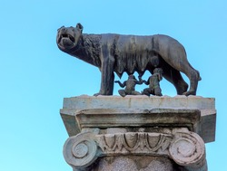 Bronze sculpture of a she-wolf breastfeeding two babies, Romulus and Remus, the symbol of Rome.