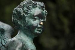 Bronze sculpture of an angel close up.