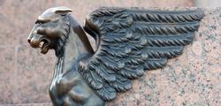Bronze sculpture of Griffin on the University Embankment of the Neva River in St. Petersburg