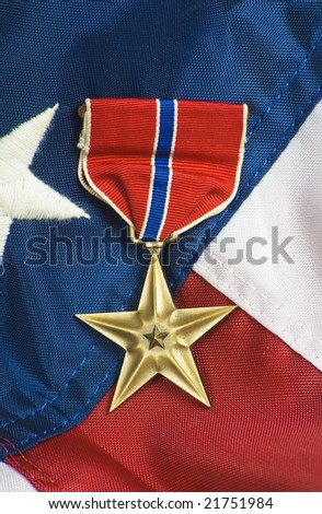 Bronze star, awarded for valor in combat.