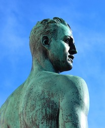 bronze statue of a man gazing into the distance