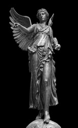 Bronze statue of a Winged Victory. Frontal view of a Statue of the goddess Nike, isolated on black background by clipping path