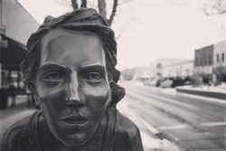Bronze statue of a woman's face.