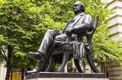 Bronze statue of American-British entrepeneur George Peabody in the City of London.