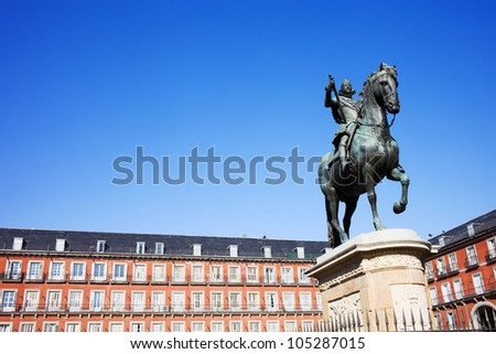 Bronze statue of King Philip III constructed in 1616 at the Plaza Mayor in Madrid, Spain, composition with copyspace.