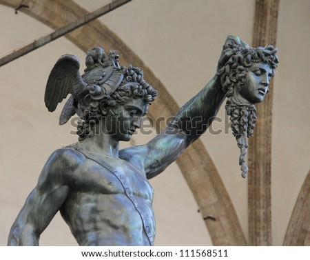 Bronze statue of Perseus holding head of Medusa in Piazza della Signoria, Florence, Italy