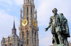 Bronze statue of the famous baroque Flemish painter Peter Paul Rubens with Cathedral of Our Lady in the back, in Antwerp, Flanders. Selective focus