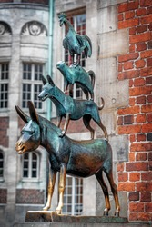 Bronze statue of the Town Musicians of Bremen in the city of Bremen in Germany. It shows the characters in a fairy tale by the Brothers Grimm.