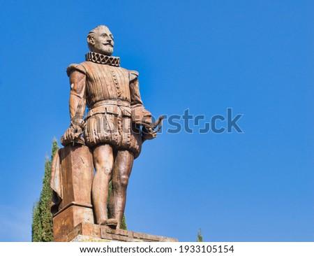 Bronze statue tribute to writer Miguel de Cervantes Saavedra in Valladolid university square