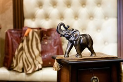 bronze statuette of an elephant in a classic interior