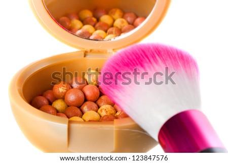 Bronzing pearls with make up brush