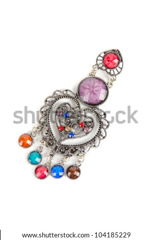 brooch with different gems isolated on a white