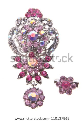 brooch with different gems on a background.