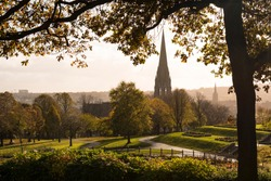 Brooke Park, Derry, Northern Ireland capturing autumn scene of rustic colours with a view of the city's cathedral in the background.