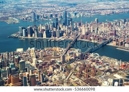 Stock Photo Brooklyn and Manhattan bridges from the airplane window.