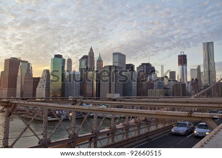 Brooklyn Bridge and Lower Manhattan closeup with skyscrapers and city skyline  in the background, New York City