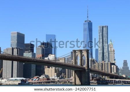 Brooklyn Bridge and Manhattan Skyline on a clear blue day, New York City #242007751