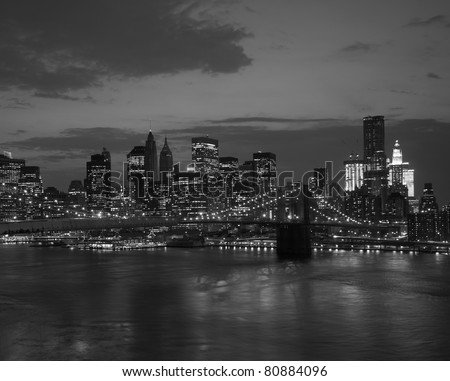 Brooklyn bridge and NYC skyline at sunset in black and white