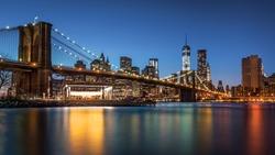 Brooklyn Bridge at dusk viewed from the Brooklyn Bridge Park in New York City.