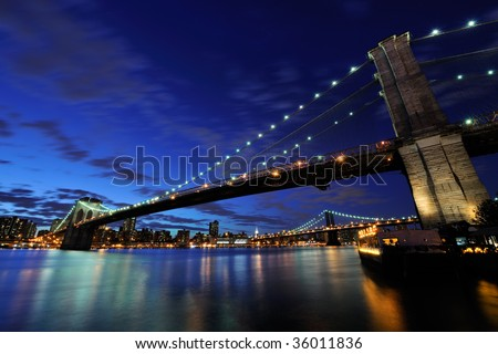 Brooklyn bridge at night - stock photo
