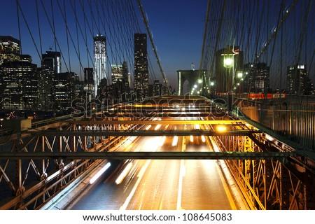 Brooklyn Bridge at night with car traffic